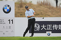 Ryan Palmer (USA) tees off the 11th tee during Friday's Round 2 of the 2014 BMW Masters held at Lake Malaren, Shanghai, China 31st October 2014.<br /> Picture: Eoin Clarke www.golffile.ie
