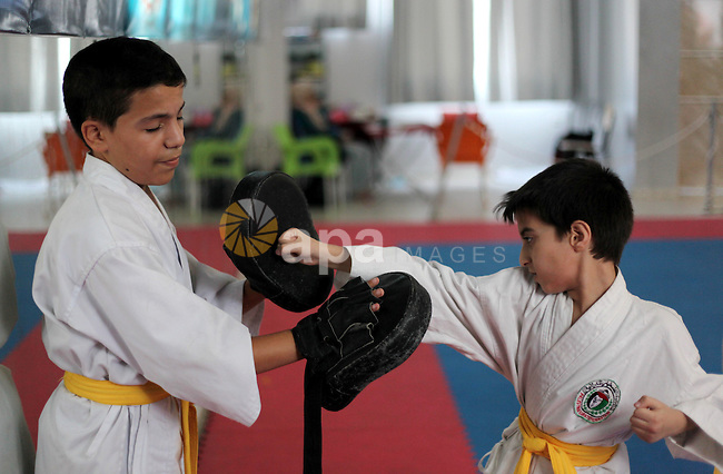 Blind and visually impaired Palestinian boys take part in a Karate class at al-Masthal club in Gaza city Sep. 06, 2015. The training is held twice a week by the club to lift the morale of the children, trainers said. Photo by Ashraf Amra