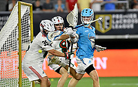 Atlas LC attack Kieran McArdle (6) attempt to score with a one-handed shot on Whipsnakes goalie Kyle Bernlohr (35), while Whipsnakes LC defender Matthew Dunn (33) watches during the Whipsnakes LC vs. Atlas LC Premier Lacrosse League (PLL) game July 6, 2019 at Audi Field in Washington, D.C..