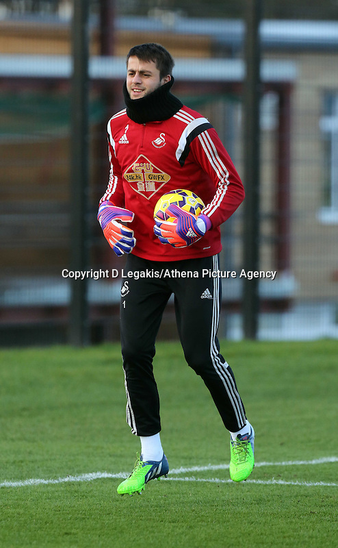 Pictured: Goalkeeper Lukasz Fabianski Wednesday 10 December 2014<br /> Re: Swansea City FC training at Fairwood Training Ground, south Wales, UK