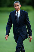 United States President Barack Obama walks across the South Lawn after arriving at the White House September 13, 2012 in Washington, DC. Obama returned to Washington after a two-day campaign trip to Nevada and Colorado..Credit: Chip Somodevilla / Pool via CNP