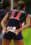 8/14/04 --Al Diaz/Miami Herald/KRT--Athens, Greece--Women's volleyball at the Peace & Friendship Stadium during the Athens 2004 Olympic Games. Robyn Ah Mow Santos, (cq) wears a photo of her son Jordan, 1 1/2 years old, on the back of her uniform.
