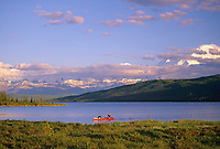 Canoeing On Wonder Lake, Denali National Park, Mt. Denali Partly Clouded On Right, Alaska