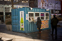 A kiosk made of a shipping container sells Hispanic street food and drink on Fulton Street in Downtown Brooklyn in New York on Saturday, January 26, 2013. (© Richard B. Levine)