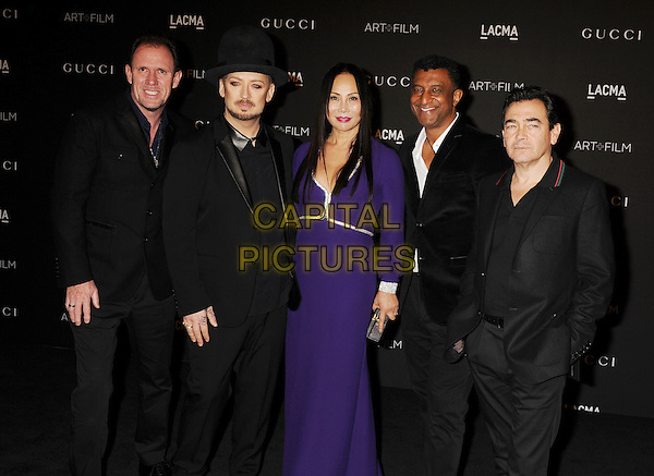 LOS ANGELES, CA - NOVEMBER 01: (L-R) Musicians Roy Hay, Boy George, Film Gala Co-Chair &amp; LACMA Trustee Eva Chow, musicians Mikey Craig and Jon Moss of Culture Club attend the 2014 LACMA Art + Film Gala honoring Barbara Kruger and Quentin Tarantino presented by Gucci at LACMA on November 1, 2014 in Los Angeles, California.<br /> CAP/ROT/TM<br /> &copy;Tony Michaels/Roth Stock/Capital Pictures
