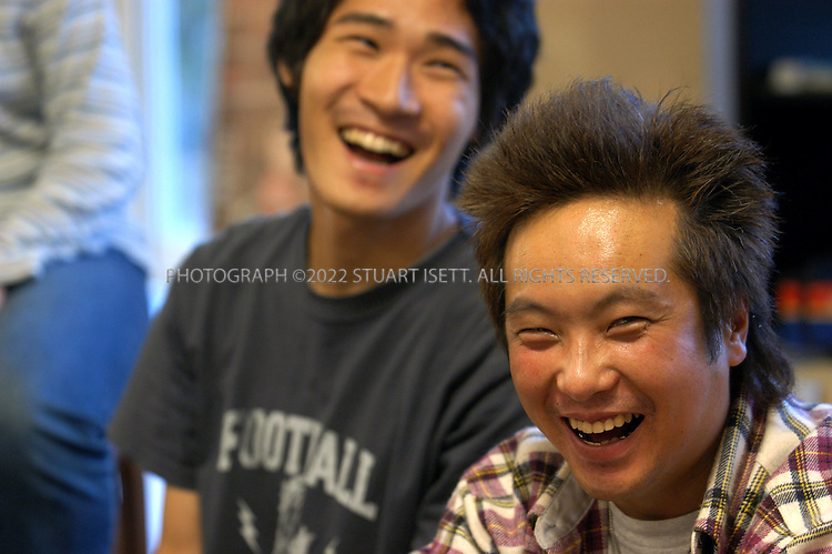 9/30/2002--Funabashi, Japan..Shotaro Yoshioka, 21, (left) and Haruo Kikuchi, 36 right, share a laugh with other 'hikikomori' or shutins who come to Dr. Saito Tamaki's clinic at the Sofukai Sasaki Hospital about 30 minutes east of Tokyo in Funabashi. Hikikomori are usually young people who withdraw from society, often spending years inside their parents' homes, never venturing out. Dr. Tamaki's program attempts to reintroduce the young people to society and teach them the skills needed to communicate with others.....All photographs ©2003 Stuart Isett.All rights reserved.This image may not be reproduced without expressed written permission from Stuart Isett.