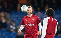Per Mertesacker of Arsenal warms up pre match during the Carabao Cup semi final 1st leg match between Chelsea and Arsenal at Stamford Bridge, London, England on 10 January 2018. Photo by Andy Rowland.
