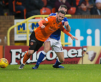 16th November 2019; Tannadice Park, Dundee, Scotland; Scottish Championship Football, Dundee United versus Queen of the South; Nicky Clark of Dundee United is tackled by Darren Lyon of Queen of the South  - Editorial Use