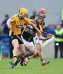 Colm Galvin of Clonlara in action against Gearoid O Connell of Ballyea during their senior county final replay at Cusack Park. Photograph by John Kelly.