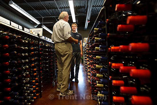 Dallon Silva (right) gives advice to customer Jim Bradley Friday, September 25 2009 at The Wine Store in Salt Lake City.