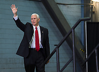 In this photo released by the National Aeronautics and Space Administration (NASA) United States Vice President Mike Pence waves before addressing NASA employees, Thursday, July 6, 2017, at the Vehicle Assembly Building at NASAís Kennedy Space Center (KSC) in Cape Canaveral, Florida. The Vice President thanked employees for advancing American leadership in space, before going on a tour of the center that highlighted the public-private partnerships at KSC, as both NASA and commercial companies prepare to launch American astronauts from the multi-user spaceport. Photo Credit: Aubrey Gemignani/NASA/CNP/AdMedia