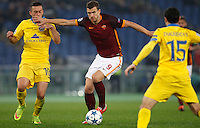 Calcio, Champions League: Gruppo E - Roma vs Bate Borisov. Roma, stadio Olimpico, 9 dicembre 2015.<br /> Roma's Edin Dzeko, center, is challenged by Bate Borisov's Nemanja Nikolic during the Champions League Group E football match between Roma and Bate Borisov at Rome's Olympic stadium, 9 December 2015.<br /> UPDATE IMAGES PRESS/Riccardo De Luca