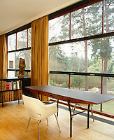 A Saarinen chair in the living room sits behind a desk by Patrick Gwynne overlooking the garden
