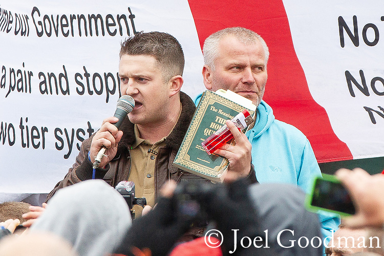 © Joel Goodman - 07973 332324 . 09/06/2012. Rochdale , UK. EDL Leader TOMMY ROBINSON (aka Stephen Yaxley-Lennon ) holds up a copy of the Koran and a large lighter as he speaks to crowds at the demonstration . The English Defence League ( EDL ) hold a march and rally in Rochdale Town Centre . Photo credit : Joel Goodman