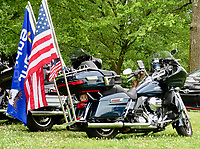 Westside Eagle Observer/RANDY MOLL Though not a part of the show, the flags on this motorcycle in the parking area indicate the purpose of the show held Saturday in Highfill — to support local veterans.