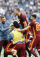 Calcio, Serie A: Lazio vs Roma. Roma, stadio Olimpico, 3 aprile 2016.<br /> Roma's Alessandro Florenzi is hidden by teammates' hugs after scoring during the Italian Serie A football match between Lazio and Roma at Rome's Olympic stadium, 3 April 2016.<br /> UPDATE IMAGES PRESS/Isabella Bonotto