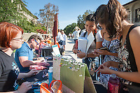 People peruse items on sale made by students and staff during Handmade Oxy on Founders Day, April 20, 2016.<br /> (Photo by Marc Campos, Occidental College Photographer)