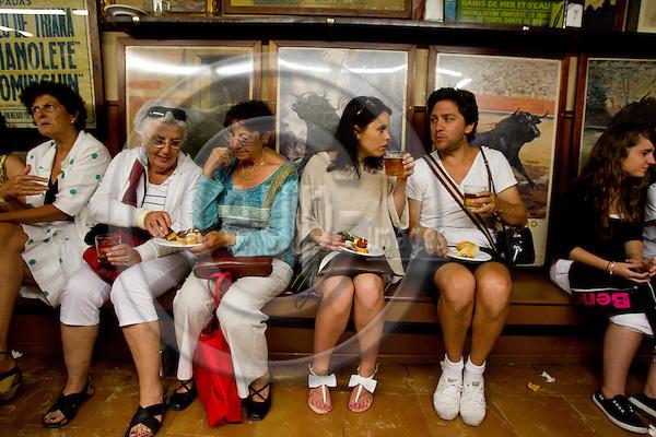 SAN SEBASTIAN - SPAIN - 23 JULY 2010 -- Locals and tourists eating tapas, or in Basques called pintxos, for lunch time at the Casa Alcalde Tapas Bar, San Sebastian. PHOTO: ERIK LUNTANG / EUP-Images.