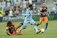 Korde Aiyegbusi (3) forward Sporting KC goes past Daniel Congre (12) defender Montpellier..Sporting Kansas City were defeated 3-0 by Montpellier HSC in an international friendly at LIVESTRONG Sporting Park, Kansas City, KS..