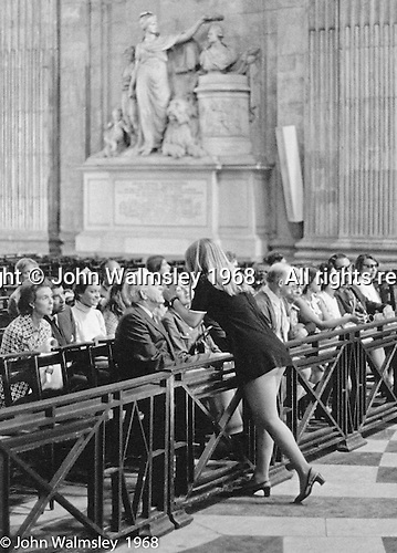 I was a photography student, had gone to St Paul's to take photos and had positioned myself so, if something happened over here or over there, I'd be in a good position.  Fairly soon a tourist group came in, the Guide sat them down, walked around the front and leant forward.  Showing this much bare bum was risque in those days.  London  1968.