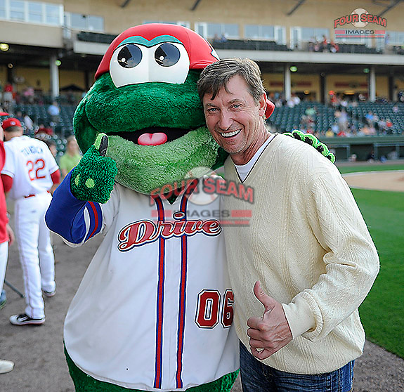 National Hockey League legend Wayne Gretzky mugs for the camera with Greenville Drive mascot Reedy Rip'It. Gretzky, in town for the BWM Charity Pro-Am golf tournament, threw out the first pitch before a game between the Greenville Drive and Charleston RiverDogs on Thursday, May 16, 2013, at Fluor Field at the West End in Greenville, South Carolina. (Tom Priddy/Four Seam Images)