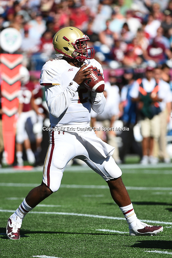 August 30, 2014 - Foxborough, Massachusetts, U.S. - Boston College Eagles quarterback Tyler Murphy (2) falls back to pass during the NCAA Division I football game between Boston College Eagles and the University of Massachusetts Minutemen held at Gillette Stadium in Foxborough Massachusetts. The Eagles defeated the Minutemen 30-7. Eric Canha/CSM