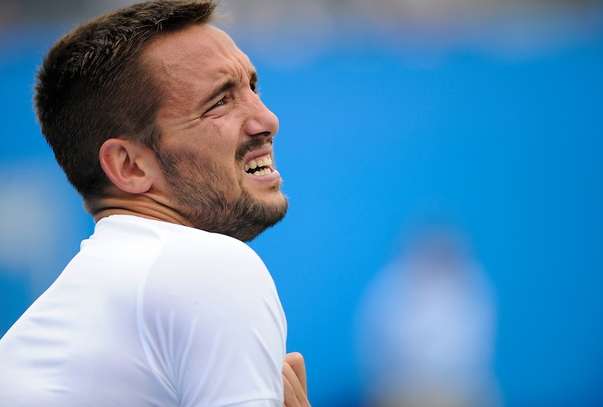 Viktor Troicki (SRB) injured during his match against Andy Murray (GBR) in their Men&rsquo;s Singles Semi Final match<br /> <br /> <br /> Photographer Ashley Western/CameraSport<br /> <br /> Tennis - ATP 500 World Tour - AEGON Championships- Day 6 - Saturday 20th June 2015 - Queen's Club - London <br /> <br /> &copy; CameraSport - 43 Linden Ave. Countesthorpe. Leicester. England. LE8 5PG - Tel: +44 (0) 116 277 4147 - admin@camerasport.com - www.camerasport.com