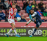 11th January 2020; Bet365 Stadium, Stoke, Staffordshire, England; English Championship Football, Stoke City versus Milwall FC; Mahlon Romeo of Millwall kplays the ball past James McClean of Stoke City - Strictly Editorial Use Only. No use with unauthorized audio, video, data, fixture lists, club/league logos or 'live' services. Online in-match use limited to 120 images, no video emulation. No use in betting, games or single club/league/player publications