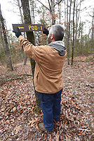 NWA Democrat-Gazette/FLIP PUTTHOFF <br /> Joe Pearson straightens    March 2019   a sign at a pod of campsites.