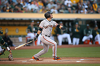 OAKLAND, CA - JULY 31:  Joe Panik #12 of the San Francisco Giants bats against the Oakland Athletics during the game at the Oakland Coliseum on Monday, July 31, 2017 in Oakland, California. (Photo by Brad Mangin)