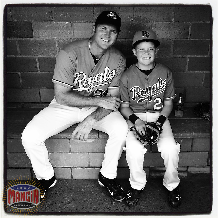 COOPERSTOWN, NY - MAY 24:  Instagram of Mike Sweeney and his son MJ sitting in the dugout before the Hall of Fame Classic game at Doubleday Field on May 24, 2014 in Cooperstown, New York. Photo by Brad Mangin