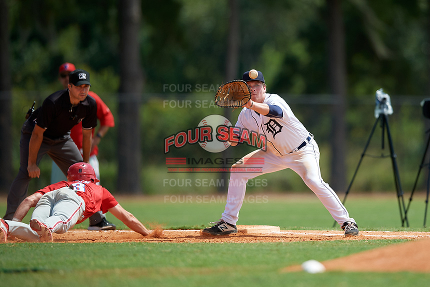 Detroit Tigers first baseman Jake Holton (64) stretches for a throw as McCarthy Tatum (3) dives back to the bag during an Instructional League game against the Philadelphia Phillies on September 19, 2019 at Tigertown in Lakeland, Florida.  (Mike Janes/Four Seam Images)
