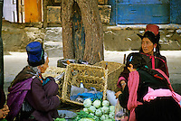 Portrait of three Tibetan women talking together at a market, Ladakh, India.