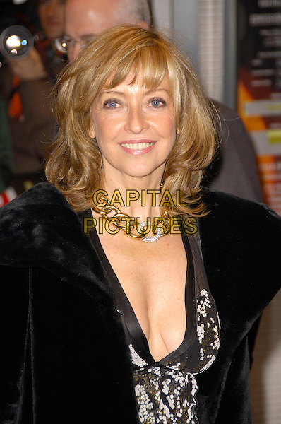 "SHARON MAUGHAN.""The Bank Job"" - UK film premiere.Odeon West End, London, England..February 18th, 2008   .half length black coat print gold necklace cleavage .CAP/CAS.©Bob Cass/Capital Pictures."