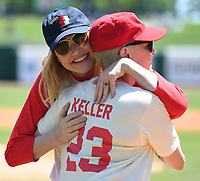 "NWA Democrat-Gazette/J.T. WAMPLER Gina Davis, left, hugs Lori Petty Sunday May 7, 2017 during the ""A League of Their Own"" reunion softball game at Arvest Ballpark in Springdale. Davis and Petty acted together in the 1992 movie. The event concluded the Bentonville Film Festival."