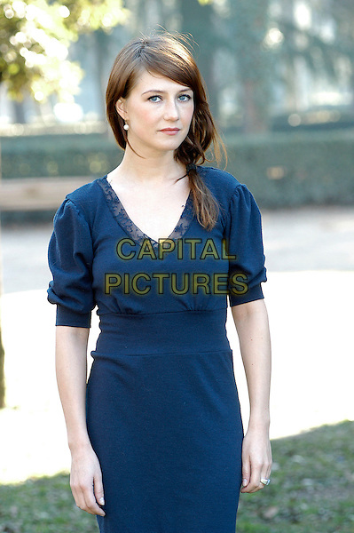 "CARICE VAN HOUTEN.Photocall for ""Black Book"" (Zwartboek) at Casa Del Cinema, Rome, Italy..January 30th, 2007.half length blue dress ponytail.Roma CAP/CAV.©Luca Cavallari/Capital Pictures"