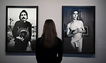 "05 June 2018, Hamburg, Germany: A woman looks at portraits by David Bowie (1980, r) and Captain Beefheart (1980) in the exhibition ""Anton Corbijn - The Living and the Dead"" at the Bucerius Kunst Forum. Photo: Daniel Reinhardt/dpa"