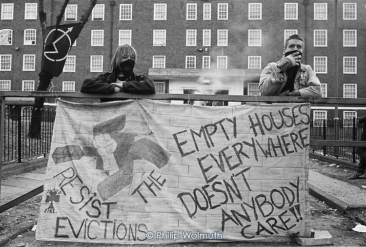 Squatters waiting for the bailiffs on Stamford Hill Estate, Hackney, the day before they were evicted; 1988.