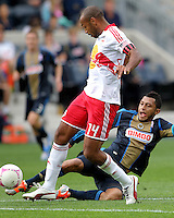 CHESTER, PA - OCTOBER 27, 2012:  Carlos Valdés (2) of the Philadelphia Union slides the ball away from  Thierry Henry (14) of the New York Red Bulls during an MLS match at PPL Park in Chester, PA. on October 27. Red Bulls won 3-0.