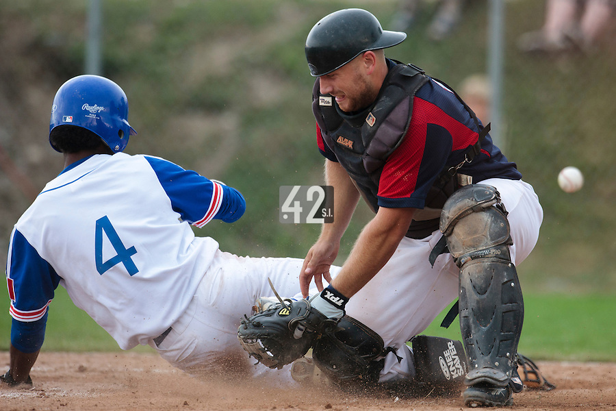 25 july 2010: Felix Brown of France slides safely into home plate as Jakub Vojak fails to keep control of the ball during France 6-1 victory over Czech Republic, in day 3 of the 2010 European Championship Seniors, in Neuenburg, Germany.