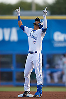 Dunedin Blue Jays shortstop Lourdes Gurriel (13) points to the sky after doubling in his first at bat during a game against the St. Lucie Mets on April 19, 2017 at Florida Auto Exchange Stadium in Dunedin, Florida.  Dunedin defeated St. Lucie 9-1.  (Mike Janes/Four Seam Images)