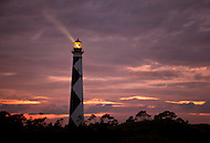 Cape Lookout Lighthouse at night with beam of light