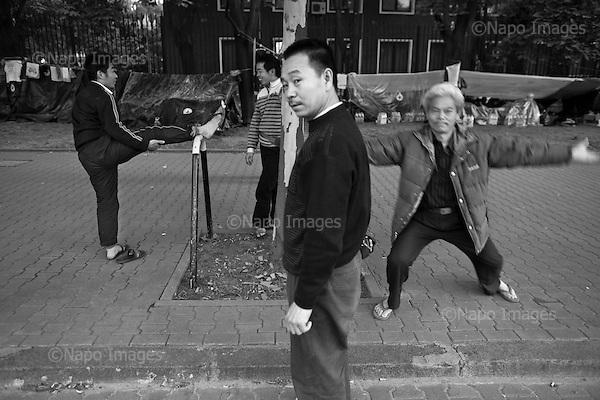 Warsaw 21 July 2009 Poland.<br /> 47 Chinese without water, food and money migrates the PRC Embassy. They are construction workers, which the company has not paid out wages outstanding.<br /> <br /> (Photo by Filip Cwik / Napo Images for Newsweek Poland)<br /> <br /> Warszawa 21 lipiec 2009 Polska.<br /> 47 Chinczykow, bez biezacej wody, jedzenia i pieniedzy koczuje pod ambasada ChRL. Sa to robotnicy budowlani ktorym firma nie wyplacila zaleglego wynagrodzenia.<br /> <br /> (fot. Filip Cwik / Napo Images dla Newsweek Polska)