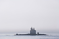 Gull Rock Lighthouse in the fog on Lake Superior near Copper Harbor Michigan.
