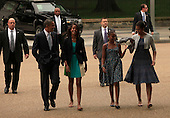 The Obamas walk from the White House to St. John's Episcopal Church on August 19, 2012.  (left to right: United States President Barack Obama, Malia Obama,Sasha Obama, first lady Michelle Obama) .Credit: Dennis Brack / Pool via CNP