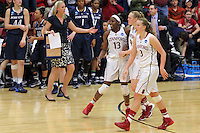 STANFORD, CA - March 30, 2014: Stanford Cardinal's Chiney Ogwumike, Taylor Greenfield, and Mikaela Ruef during Stanford's 82-57 victory over Penn State in the third round of the 2014 NCAA Women's Basketball Tournament at Maples Pavilion.