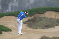 Matthew Baldwin (ENG) plays his 2nd shot from fairway bunker on the 5th hole during Saturay's Round 3 of the 2014 BMW Masters held at Lake Malaren, Shanghai, China. 1st November 2014.<br /> Picture: Eoin Clarke www.golffile.ie