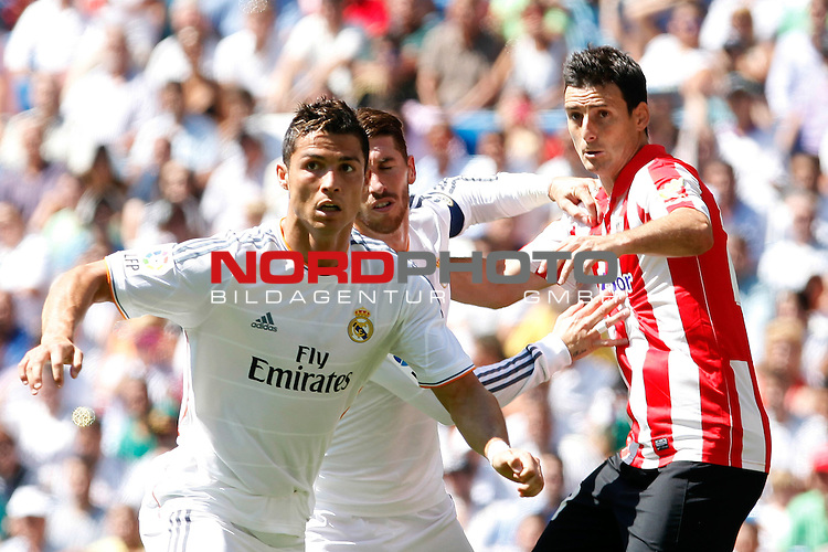 Real Madrid's Cristiano Ronaldo, Sergio Ramos and Athletic Club's Aduriz during La Liga Match. September 01, 2013. Foto © nph / Caro Marin)