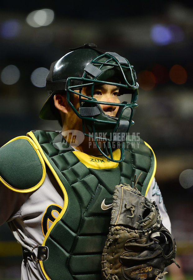 Jun. 8, 2012; Phoenix, AZ, USA; Oakland Athletics catcher Kurt Suzuki against the Arizona Diamondbacks at Chase Field.  Mandatory Credit: Mark J. Rebilas-