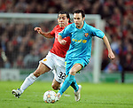 Andres Iniesta of Barcelona shadowed by Manchester United's Carlos Tevez during the Champions League semi-final 2nd leg match at Old Trafford, Manchester. Picture date 29th April 2008. Picture credit should read: Simon Bellis/Sportimage